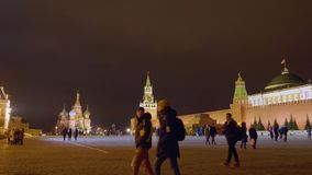 Moscow, Russia - March 21, 2019: Red Square with night illumination. Moscow Kremlin in night light. People walking on. Kremlin and Red Square landscape stock video