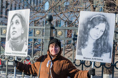Russian activist holds placards with portraits of Nadezhda Tolok Stock Images