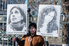 Russian activist holds placards with portraits of Nadezhda Tolok Stock Photo