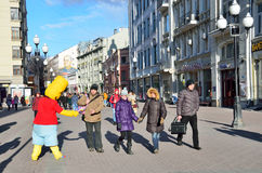Moscow, Russia, March, 20, 2016, Russian scene: people walking on Arbat street in spring. Moscow, Russia, March, 20, 2016, people walking on Arbat street in Royalty Free Stock Photos
