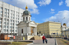 Moscow, Russia, March, 20, 2016, Russian scene: people walking near the chapel of the Holy martyrs Boris and Gleb Stock Photos