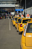 MOSCOW, RUSSIA - March 10. 2016. Several yellow taxis near  Kursk railway station Royalty Free Stock Photo