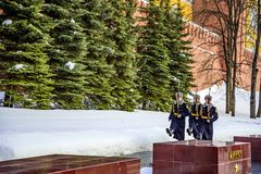 Soldiers of the Kremlin regiment go to change guard near the Eternal Flame and the Tomb of the Unkn. Moscow, Russia-March 19, 2018: Soldiers of the Kremlin Royalty Free Stock Image