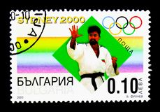 Judo, Summer Olympics 2000, Sydney serie, circa 2000. MOSCOW, RUSSIA - MARCH 18, 2018: A stamp printed in Bulgaria shows Judo, Summer Olympics 2000, Sydney serie Stock Images