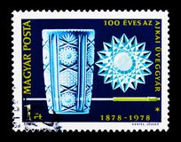 Ajka Glass Works, centenary, Anniversary serie, circa 1978. MOSCOW, RUSSIA - MARCH 18, 2018: A stamp printed in Hungary shows Ajka Glass Works, centenary stock photo