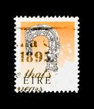 Bishop`s Crosier of Lismore c. 1100 - Photogravure, Irish Heritage and Treasures  serie, circa 1991. MOSCOW, RUSSIA - MARCH 18, 2018: A stamp printed in Ireland Royalty Free Stock Photography