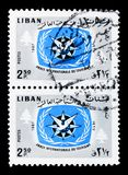 Two postage stamps, ITY Emblem and Cedars, International Tourist. MOSCOW, RUSSIA - MARCH 18, 2018: A stamp printed in Lebanon shows Two postage stamps, ITY stock photos