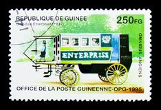 Omnibus Enterprise - 1832, Historic Buses serie, circa 1995. MOSCOW, RUSSIA - MARCH 18, 2018: A stamp printed in Republic of Guinea shows Omnibus Enterprise Stock Images