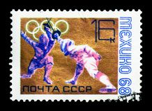 Olympics - Fencing, Olympic Games 1968 - Mexico serie, circa 196. MOSCOW, RUSSIA - MARCH 18, 2018: A stamp printed in shows Olympics - Fencing, Olympic Games Royalty Free Stock Photography