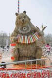 Straw stuffed bear with an accordion at Russian national festival `Shrove` in the park VDNKh in Moscow. Moscow, Russia - March 11, 2016: Straw stuffed bear with Stock Photography