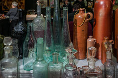 Moscow, Russia - March 19, 2017: Table at the flea market with vintage bottles and flacons of different sizes and colors Stock Photo