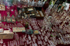 Moscow, Russia - March 19, 2017: Table at the flea market with vintage bottles and flacons of different sizes and colors Royalty Free Stock Image