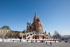 MOSCOW, RUSSIA - MARCH 28, 2013: Tourists walk on the red square. Red square-the Central square of Moscow. Stock Photo