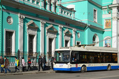 Moscow, Russia - March 14, 2016. Trolley bus at  bus stop in front of Cathedral  Epiphany at  street Spartacus Royalty Free Stock Photos
