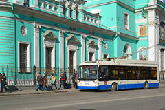 Moscow, Russia - March 14, 2016. Trolley bus at  bus stop in front of Cathedral  Epiphany at  street Spartacus Royalty Free Stock Images