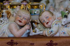 Moscow, Russia - March 19, 2017: Vintage collection porcelain figurines of ruddy boys and girls of the Victorian era stock image