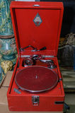 Moscow, Russia - March 19, 2017: Vintage red gramophone for sale on the antique market. Old phonograph made in the USSR Royalty Free Stock Image