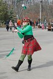 Woman spinning poi at the St. Patrick`s Day Parade in the park Sokolniki in Moscow stock images