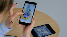 Woman using smartphone with architectural augmented reality app