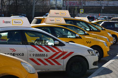 Moscow, Russia - March 14, 2016. Yandex taxis standing in row Royalty Free Stock Images