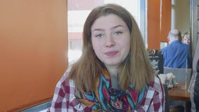 MOSCOW, RUSSIA - 8 MART 2018: Young long haired caucasian blonde with snow-white skin drinks from white cup, smiles and. MOSCOW, RUSSIA - 8 MART 2018: Young long stock video