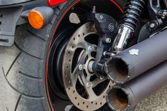 Free Moscow, Russia - May 04, 2019: Rear Wheel And Exhaust System Pipes Of Harley Davidson Motorcycle Closeup. Moto Festival Royalty Free Stock Images - 147239919