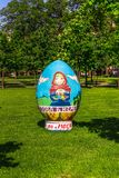 Moscow, Russia - May 18, 2019: Big symbolic easter egg on green grass royalty free stock image