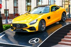 Mercedes-AMG GT S. Moscow, Russia - May 2, 2018: Brand new yellow supercar Mercedes-AMG GT S in the city street Stock Image
