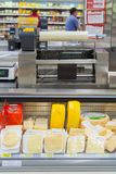 Cheese department in a supermarket royalty free stock photos