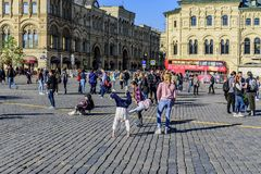 Tourists, young gymnasts and other people on Red Square the day after the Victory Day parade. Moscow, Russia. stock photo