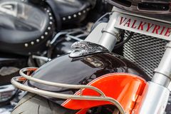 Moscow, Russia - May 04, 2019: Chrome finish figurine of eagle head on a glossy black and red front fender of Honda Valkyrie. Motorcycle closeup. Moto festival royalty free stock photos