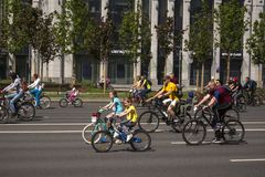 Moscow. Russia. 19 may 2019. Moscow Cycling festival 2019. Happy young cyclists, a boy and a girl ride together.  royalty free stock image
