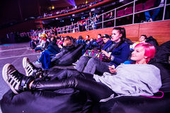 MOSCOW, RUSSIA - MAY 14 2016: EPICENTER MOSCOW Dota 2 cybersport event. Tournament spectators relaxing on the poufs Royalty Free Stock Image