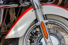 Moscow, Russia - May 04, 2019: Front wheel with red and white front fender of Kawasaki Vulcan tourist motorcycle closeup. Moto. Festival MosMotoFest 2019 stock photo