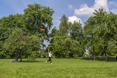 Moscow. Russia. 26 may 2019. The girl launches a kite in the Park.  stock images