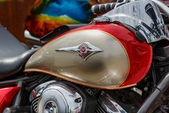 Moscow, Russia - May 04, 2019: Glossy red and bronze fuel tank of motorcycle with Kawasaki Vulcan emblem closeup. Moto festival. MosMotoFest 2019 stock photography