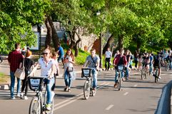 Gorky Central Park of Culture and Leisure full of locals, people ride bicycles. Moscow, Russia-May 27,2018: Gorky Central Park of Culture and Leisure full of stock image