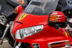 Moscow, Russia - May 04, 2019: Headlights in bright red windproof shield of tourist trike Honda Gold Wing closeup. Moto festival. MosMotoFest 2019 stock image