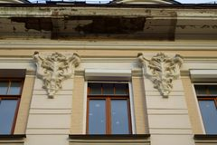 Window with bas-reliefs of plant shape stock images