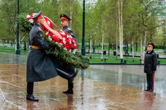 MOSCOW, RUSSIA - MAY 08, 2017: The Honor Guard of the 154 Preobrazhensky Regiment in the infantry uniform laying flowers to the To. Mb of Unknown soldier and Stock Photo