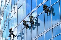 Industrial climbers wash windows of skyscraper Royalty Free Stock Photo