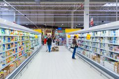 The interior of a supermarket with consumers. Moscow, Russia, may 2018: The interior of a supermarket with consumers editorial royalty free stock photography