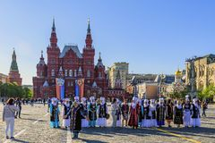 Joyful people from the Republic of Kyrgyzstan in national attire on Red Square stock image