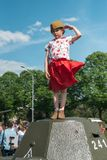 MOSCOW, RUSSIA - MAY 9, 2016. Little girl in a red skirt and forage-cap is standing on a tank of the Second World War royalty free stock image