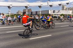 Moscow. Russia. 19 may 2019. Moscow Cycling festival Velofest 2019. Funny bike lovers go on the bridge. The cyclist does tricks