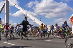 Moscow. Russia. 19 may 2019. Moscow Cycling festival Velofest 2019. Funny bike lovers go on the bridge stock images