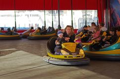 Mother and son ride attraction`Circuit` in VDNKh in Moscow royalty free stock photos