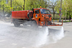 MOSCOW, RUSSIA - MAY 08,2015: Multipurpose road machine KamAZ which can operate as dump truck or as street cleaner for washing roa Royalty Free Stock Photo