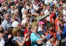 People during the celebration of Victory Day are watching a concert at the Exhibition of Economic Achievements. MOSCOW, RUSSIA - MAY 9, 2016:People during the Royalty Free Stock Images