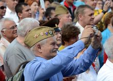 People during the celebration of Victory Day are watching a concert at the Exhibition of Economic Achievements. MOSCOW, RUSSIA - MAY 9, 2016:People during the Royalty Free Stock Photos